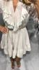 Sukienka różowa w kratkę z żabotem i gipiurą S/M