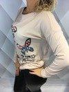 Sweter w motyle różowy